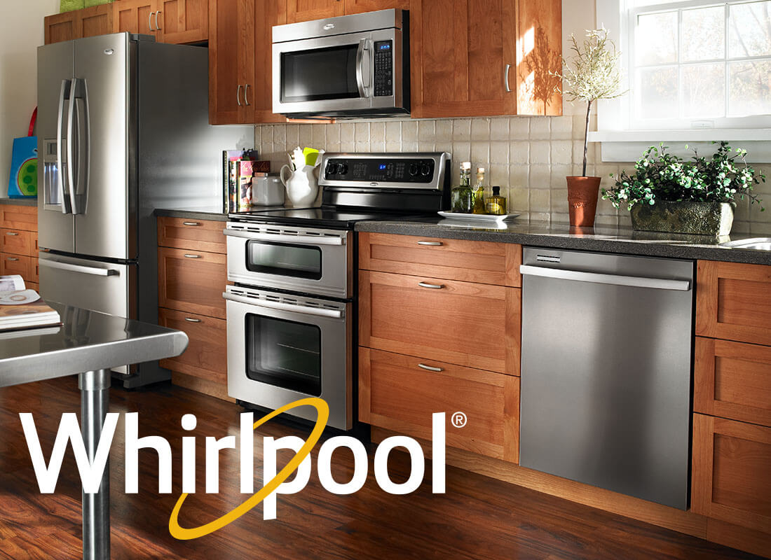 Whirlpool appliances in kitchen.